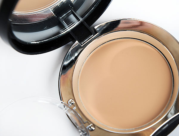 A powder foundation, of course. We love the versatility of a good solid base—when used dry, you get a matte, velvety texture, but when applied with a .